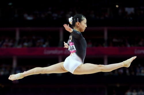 LONDON, ENGLAND - AUGUST 02:  Asuka Teramoto of Japan competes on the balance beam in the Artistic Gymnastics Women's Individual All-Around final on Day 6 of the London 2012 Olympic Games at North Greenwich Arena on August 2, 2012 in London, England.  (Photo by Streeter Lecka/Getty Images)