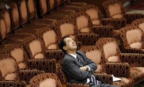 Japan's Finance Minister Kan attends the Upper House Budget Committee at the parliament in Tokyo